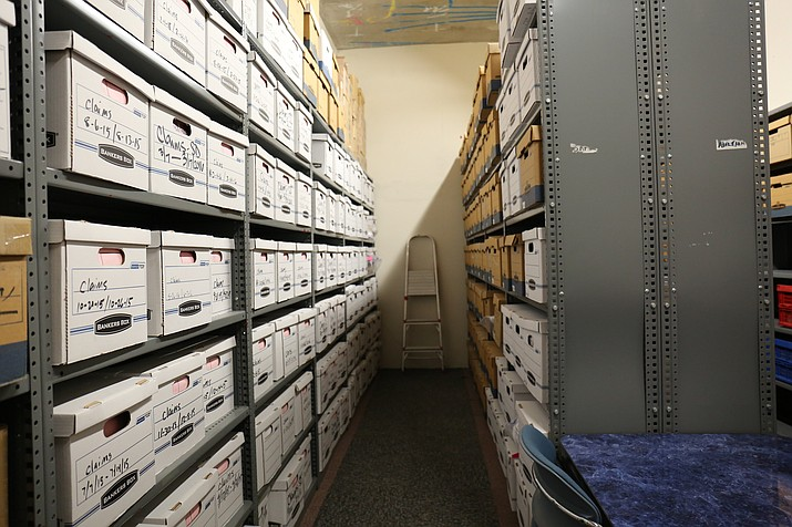 Arizona Department of Revenue has a vault full of unclaimed property such as coins, jewelry, stamps, old baseball cards and other collectibles from abandoned safe deposit boxes.