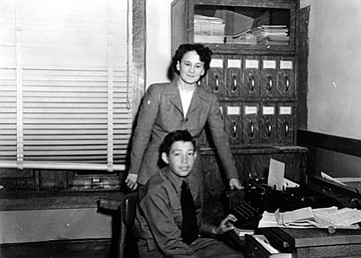 Standing, Fay Logsdon, Mohave County School Superintendent, seated George Boone on Civic Day 1947.