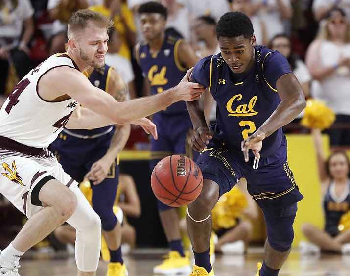 California guard Juhwan Harris-Dyson (2) steals the ball from Arizona State guard Kodi Justice during the first half of an NCAA college basketball game Thursday, March 1, 2018, in Tempe.