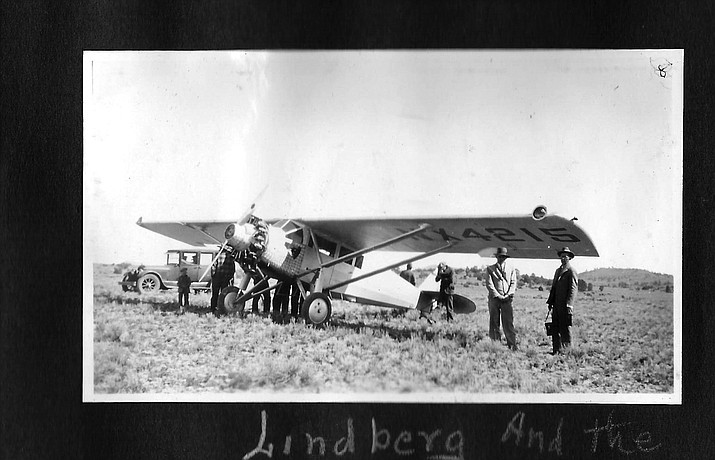 Williams residents view Charles Lindbergh's Ryan Brougham single-engine plane in Williams in 1928. E.O. Messimer's 1925 Dodge is in the background.