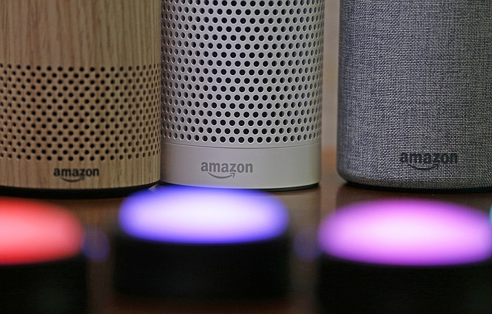 Amazon Echo and Echo Plus devices are pictured near illuminated Echo Button devices during an event last year announcing several new Amazon products. The Seattle-based company is expanding its home-security business, including by buying Ring, the maker of Wi-Fi-connected doorbells. That deal comes months after the online retailer began selling its own Wi-Fi-connected indoor security cameras. (Elaine Thompson/AP, File)