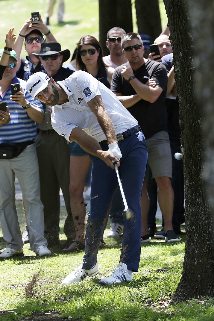 Dustin Johnson of the United States bounces a ball off a tree during the first round of the Mexico Championship at the Chapultepec Golf Club in Mexico City, Thursday, March 1, 2018.