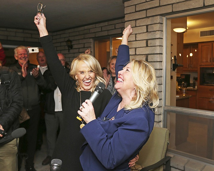 During a party at the home of former state Sen. Debbie Lesko, the Republican candidate for Congressional District 8, pictured at right, celebrated with former Arizona Gov. Jan Brewer, following the announcement Tuesday, Feb. 27, of the primary election results. The special election is being held to replace Arizona Republican Rep. Trent Franks, who resigned amid accusations of sexual misconduct. Lasko is favored to win the general election, which is set for April 24. (AP Photo/Ralph Freso)
