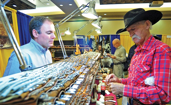 Terry Milliken of Wickenburg, chats with Barry King, owner of Barry King Tools, about his different leather stamps at the Prescott Resort.