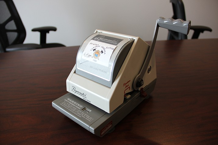 A check embossing machine used by the boards of the Central Yavapai Fire District, Chino Valley Fire District and Central Arizona Fire and Medical Authority.