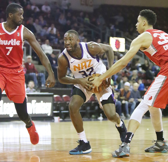 Northern Arizona Suns guard Davon Reed (32) gets pressure inside as the Suns play Memphis at the Prescott Valley Event Center on Friday, March 2, 2018.