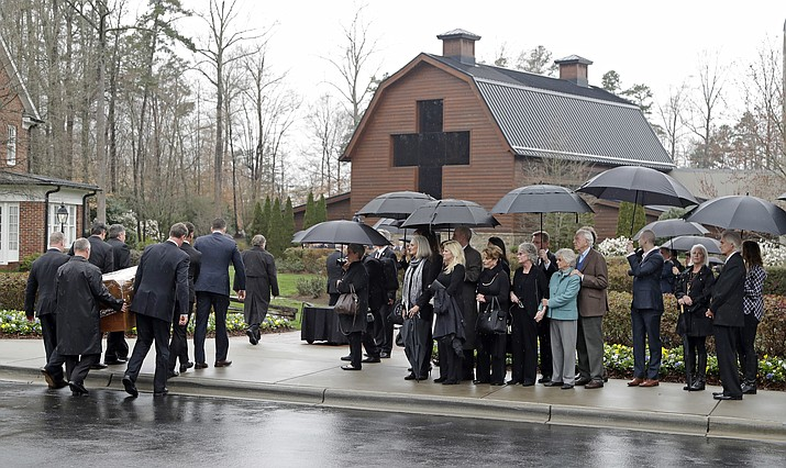 Pallbearers carry the casket of Rev. Billy Graham past family members as it returns to the Billy Graham Library in Charlotte, N.C. (Andrew Harnik/AP)