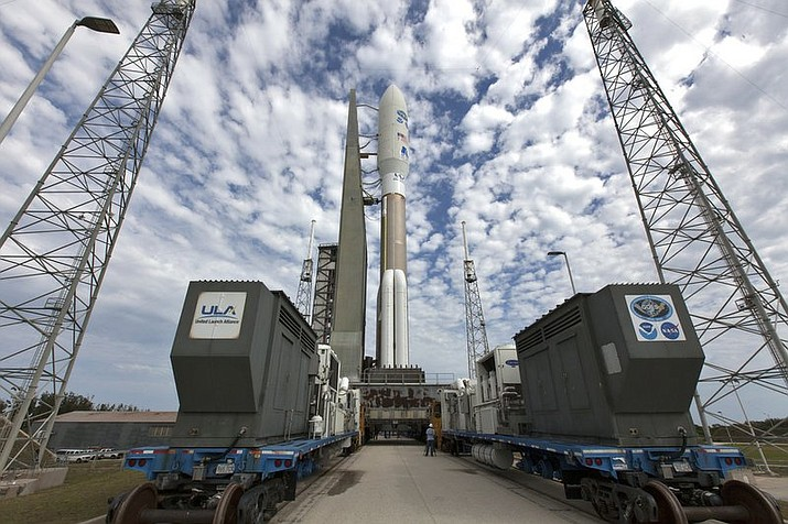 In this undated photo provided by NASA, a United Launch Alliance Atlas V rocket, waitin for liftoff on Thursday, March 1, 2018, is rolled to Space Launch Complex 41 at Cape Canaveral Air Force Station in Florida. GOES-S is the second satellite in an approximately $11 billion effort that's already revolutionizing forecasting with astonishingly fast, crisp images of hurricanes, wildfires, floods, mudslides and other natural calamities. (Ben Smegelsky/NASA)