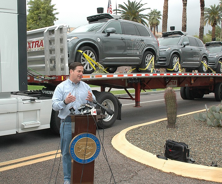 Governor Doug Ducey talks about the ramification of the driverless cars behind him on the truck bed. (Courtesy)