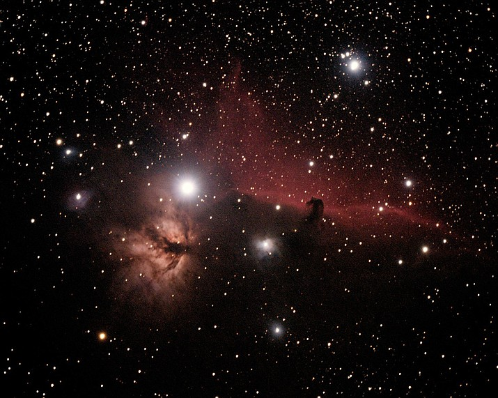 The Flame and Horsehead Nebulas, NGC 2024 and IC 434, respectively. These are examples of emission and dark nebulas. Emission nebulas are excited by radiation from hot, young stars hidden behind the glowing gas. Dark nebulas are dust clouds that obscure and block light from objects behind them. These nebula lie about 1500 light years away in the constellation Orion, the Hunter, visible high overhead this time of year. These nebula are South, and slightly East of the Easternmost star in Orion's belt. (Photo Courtesy HDAC members)