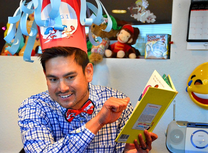 Ryan Bigelow, the new Cottonwood Library Manager, reads a Dr. Seuss book during the library's Dr. Seuss Birthday Party for small children Thursday morning. (VVN/Vyto Starinskas)
