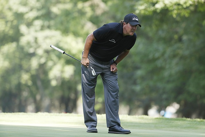 Phil Mickelson of the United States lines up his putt on the 16th hole in the third round of the Mexico Championship at the Chapultepec Golf Club in in Mexico City, Saturday, March 3, 2018. He is in the final group for the first time in two years.