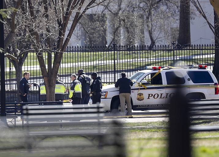 Law enforcement officers gather infront of the White House in Washington, Saturday, March 3, 2018.