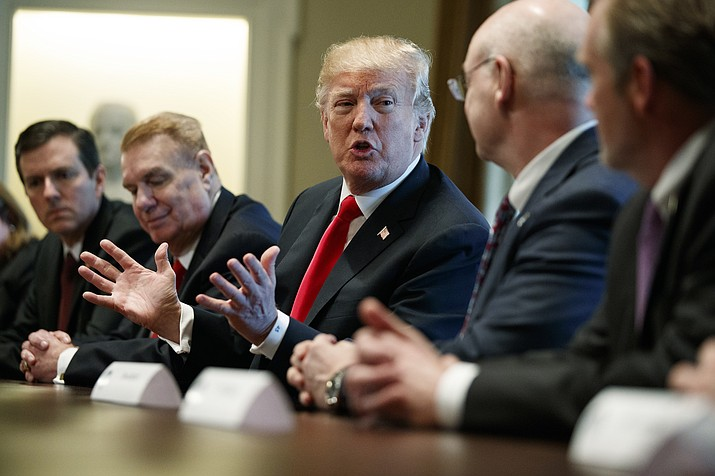 President Donald Trump speaks during a meeting with steel and aluminum executives in the Cabinet Room of the White House, Thursday, March 1, 2018, in Washington. From left, John Ferriola of Nucor, Trump, and Dave Burritt of U.S. Steel Corporation. (AP Photo/Evan Vucci)