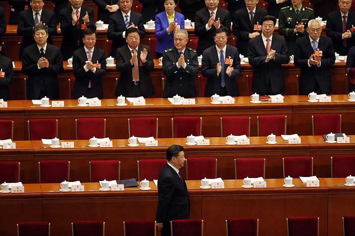 Chinese President Xi Jinping arrives for the opening session of the annual National People's Congress in Beijing's Great Hall of the People, Monday, March 5, 2018. (AP Photo/Ng Han Guan)