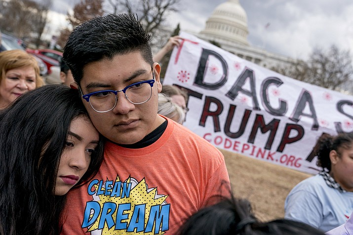 In this Jan. 23, 2018, file photo, immigration advocates hold a rally on Capitol Hill in Washington. (Andrew Harnik/AP, File)