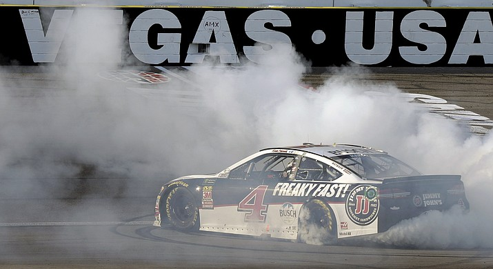 Kevin Harvick performs a burnout after winning a NASCAR Cup series auto race Sunday, March 4, 2018, in Las Vegas. (Isaac Brekken/AP)