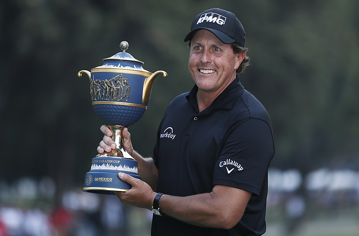 Phil Mickelson, of the U.S., poses with his Mexico Championship trophy at the Chapultepec Golf Club in Mexico City, Sunday, March 4, 2018. (Eduardo Verdugo/AP)
