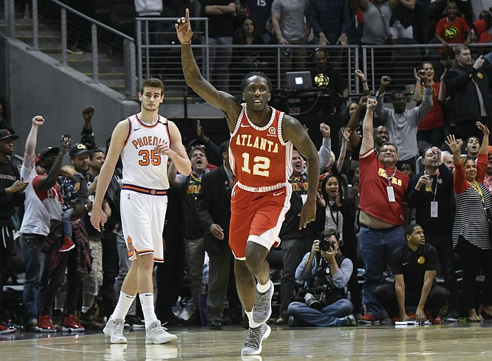 Atlanta Hawks forward Taurean Prince (12) reacts as Phoenix Suns forward Dragan Bender (35) looks on as the game comes to an end Sunday, March 4, 2018, in Atlanta. (John Amis/AP)