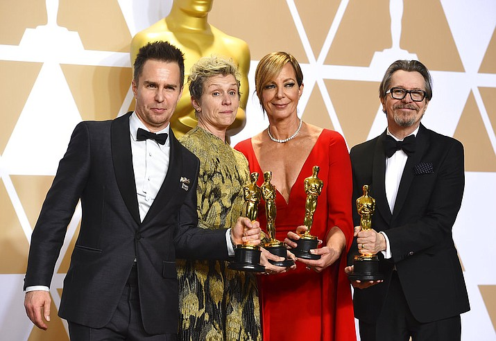 """Sam Rockwell, from left, winner of the award for best performance by an actor in a supporting role for """"Three Billboards Outside Ebbing, Missouri"""", Frances McDormand, winner of the award for best performance by an actress in a leading role for """"Three Billboards Outside Ebbing, Missouri"""", Allison Janney, winner of the award for best performance by an actress in a supporting role for """"I, Tonya"""", and Gary Oldman, winner of the award for best performance by an actor in a leading role for """"Darkest Hour"""", pose in the press room at the Oscars on Sunday, March 4, 2018, at the Dolby Theatre in Los Angeles. (Photo by Jordan Strauss/Invision/AP)"""