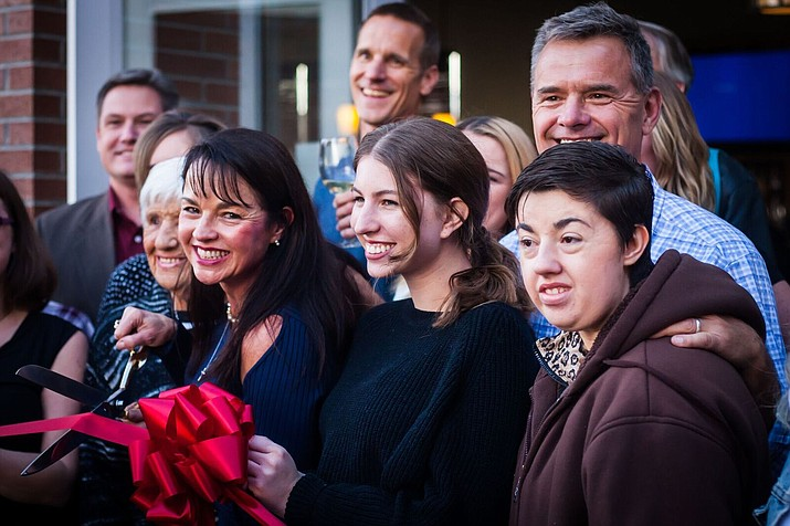 From left, front: Lori Wasowicz, Dawn Wasowicz, owner, Miranda Boshell, Arin Wasowicz, with from left, second row: Yavapai Supervisor Jack Smith, Anthony Wasowicz and Jeff Wasowicz, at the ribbon cutting Feb. 23 for Rafter Eleven in Prescott Valley.