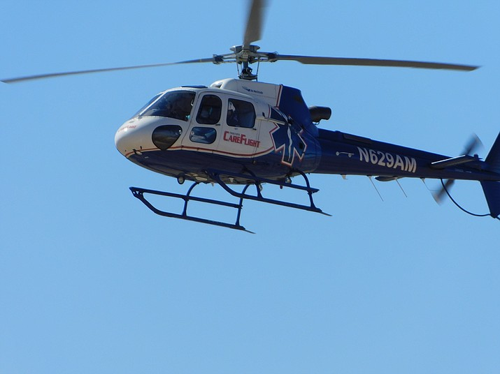 Pictured is one of three helicopters used to transport those injured in a double-fatality crash Thursday at U.S. Highway 93 and Pierce Ferry Road near Kingman, Arizona. Authorities say two Chinese tourists who were passengers in a Toyota van were killed when their driver crossed the highway eastbound and failed to stop at the crossover stop sign. They entered the path of a Ford van. (Courtesy photo by Bert Bengtson)