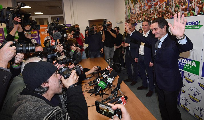 "Attilio Fontana, candidate for the Presidency of the Lombardia Region, celebrates his victory in his electoral campaign headquarters in Milan, Italy, Monday, March 5, 2018. In January, Fontana told Radio Padania, the mouthpiece of his anti-migrant League party, that being unwilling to ""accept all"" immigrants isn't ""xenophobic or racist,"" but logical. He said Italy needs to decide ""if our white race, our society, must continue to exist or be canceled out."" (Daniel Dal Zennaro/ANSA via AP)"