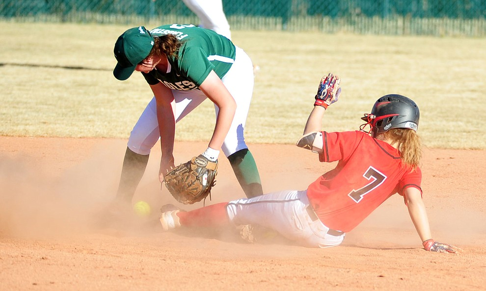 Bradshaw Mountain's Shelby Dilcher slides safely into second base as the Bears take on the Flagstaff Eagles in softball Tuesday in Prescott Valley. (Les Stukenberg/Courier)