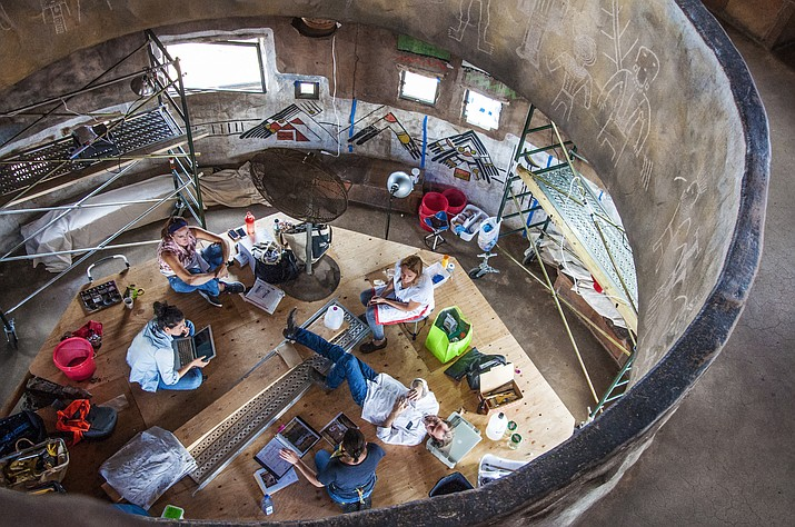 Conservationists formulate a plan for cleaning and maintaining the artwork in Desert View Watchtower, along with the tower itself. (Photo/NPS)
