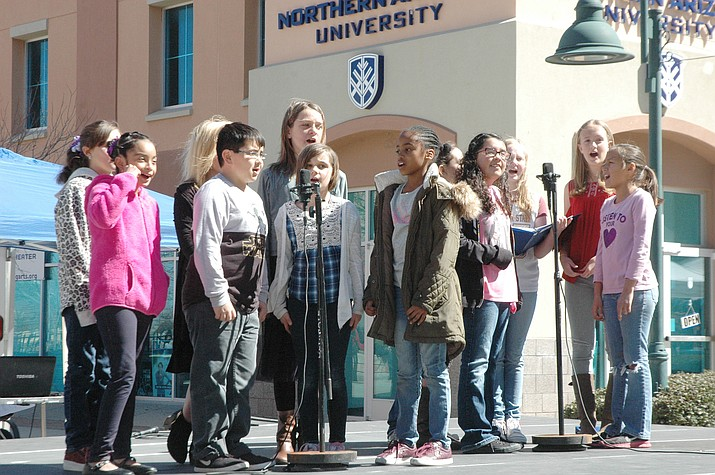 The Mountain View Elementary School choir, made up of children from third, fourth, fifth and sixth grades, performed at the Humboldt Unified School District School Expo in the Prescott Valley Entertainment District Saturday, March 3. Schools from all over the district presented at the expo, and booths and information were available. (Jason Wheeler/Tribune)