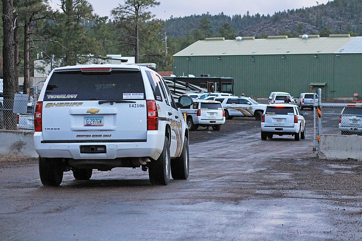 The ADOT yard fills with law enforcement vehicles during the search for a fleeing driver who shot at deputies in March 2017.