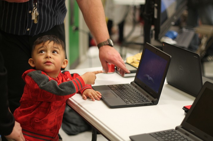 A young student proves it's never too early to learn about coding at STEAM night. (Erin Ford/WGCN)