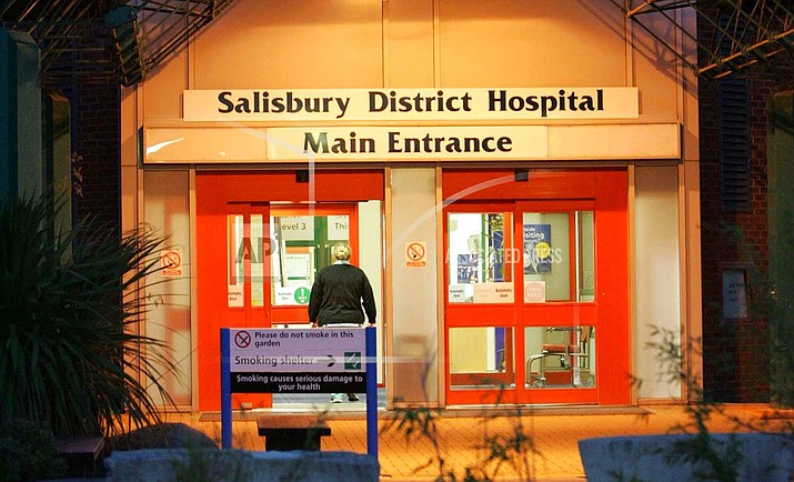 "This is a Aug. 16, 2005 file photo of the main entrance of Salisbury District Hospital, in Salisbury, England. British media say a former Russian spy is in critical condition after coming into contact with an ""unknown substance."" Authorities did not identify the man, but the Press Association and other British media identified him Monday, March 5, 2018 as Sergei Skripal who was convicted in 2006 on charges of spying for Britain and sentenced to 13 years but was freed in 2010 in a U.S.-Russian spy swap. (Tim Ockenden/PA via AP, File)"