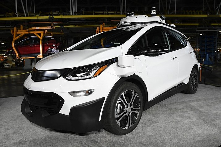 In this Tuesday, June 13, 2017, file photo, a self-driving Chevrolet Bolt EV that is in General Motors Co.'s autonomous vehicle development program appears on display at GM's Orion Assembly in Lake Orion, Mich. One problem with self-driving cars is people. The Los Angeles Times reports that of six crash reports filed in California in 2018, two involved a person attacking a robot car. Both incidents happened in San Francisco, according to Department of Motor Vehicles records. (Jose Juarez/Detroit News via AP, File)