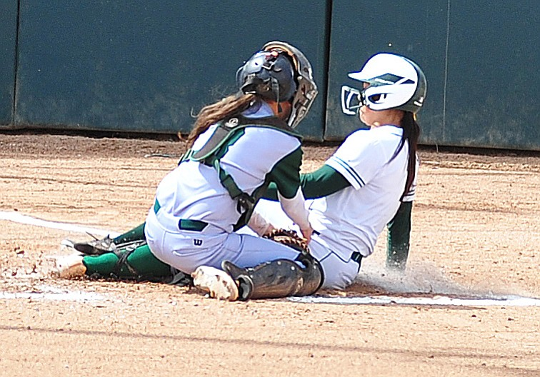 Yavapai's Makayla Guerra slides safely home as the Roughriders take on the Scottsdale Community College Artichokes Tuesday afternoon in Prescott. (Les Stukenberg/Courier)