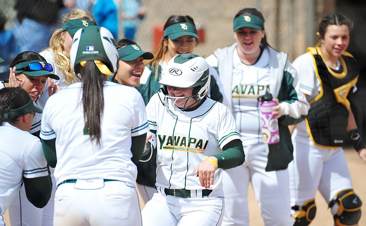 Yavapai's Brianna Griffiths gets greeted by her teammates after a solo homer as the Roughriders hosted Scottsdale Community College on Tuesday, March 6, 2018, in Prescott. (Les Stukenberg/Courier)