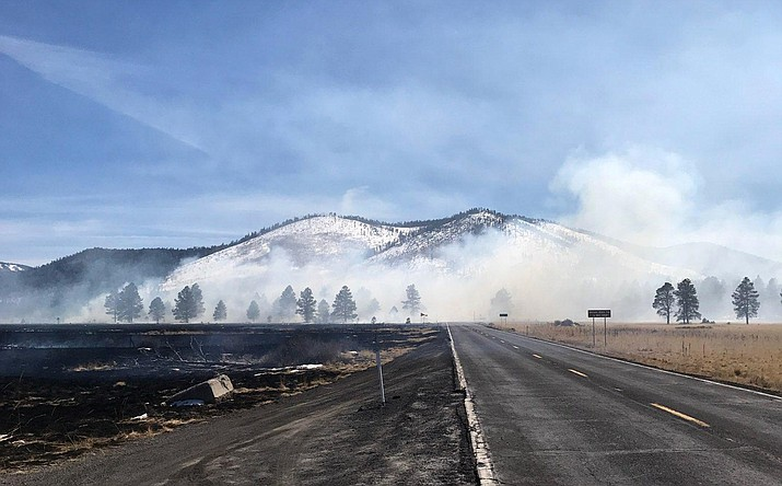 Around 30 firefighters are working to stop a wildfire from a reported drone on fire in the grasslands northwest of Flagstaff. (Photo/Coconino National Forest)