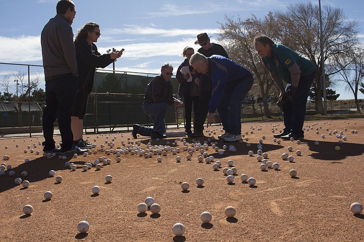 Judge David Huerta validates the winning golf ball at Saturday's Golf Ball Drop hosted by The Kingman Mohave Lions Club.