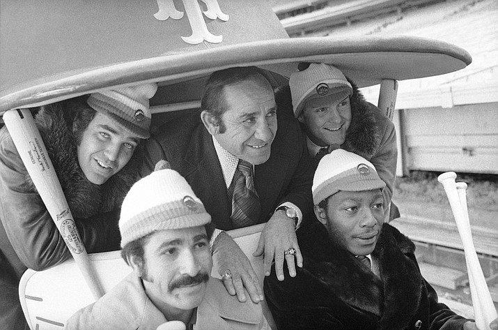 "In this January 1973 photo, New York Mets manager Yogi Berra, center, poses in the team cart at Shea Stadium in New York with four who signed with the baseball team earlier in the day. They are, back row and from left: Ed Kranepool, Berra, and Tug McGraw. Front row, from left: Felix Millan and John Milner. Cleon Jones also signed, but was not present for the picture session. Bullpen buggies are rolling back, and Cleveland Indians manager Terry Francona is positively bug-eyed about the prospect. ""I love it. I love it. I love it,"" he said Tuesday, March 6, 2018. Nearly a quarter-century since relievers stopped catching rides to the mound, the bullpen cart will become the latest retro feature to make a return to the big leagues. (AP Photo, File)"