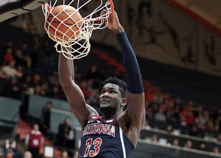 In this Feb. 22, 2018, file photo, Arizona's Deandre Ayton (13) gets behind the Oregon State defense for a dunk during the second half in Corvallis, Ore. Ayton was selected to the AP All-Pac-12 team on Tuesday, March 6, 2018. (Timothy J. Gonzalez/AP, File)