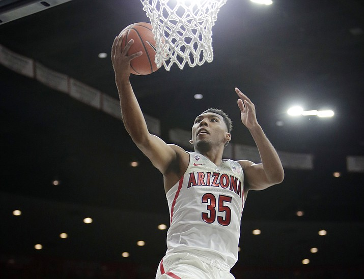 In this March 3, 2018, file photo, Arizona guard Allonzo Trier (35) scores against California during the second half in Tucson. Trier was selected to the AP All-Pac-12 team on Tuesday, March 6, 2018. (Rick Scuteri/AP, File)