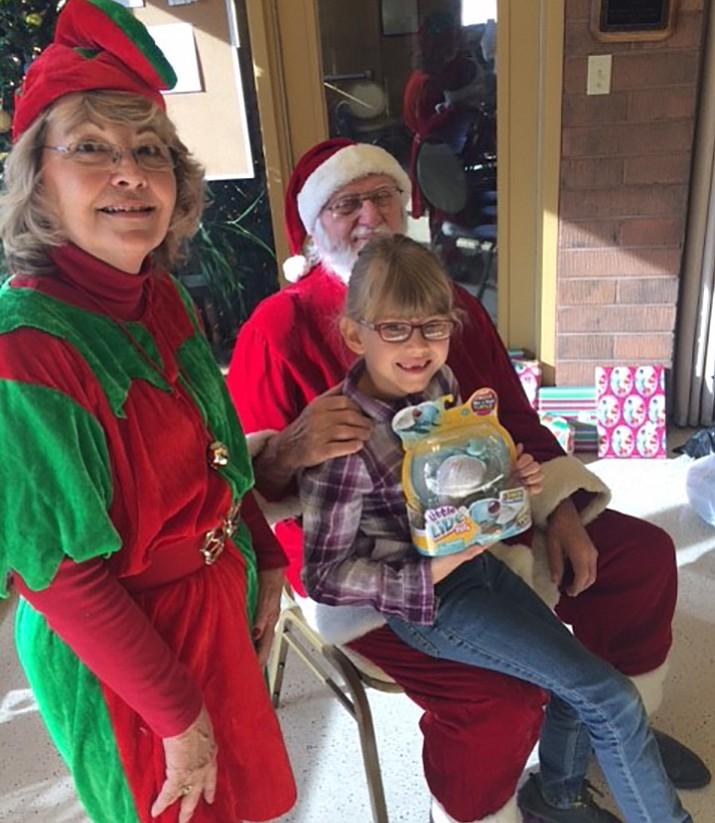 Santa Claus (Bill Kountanis) and Elf (Roxann Lathrop), with Carlie, bring Breakfast with Santa to Chino Valley children in 2017.