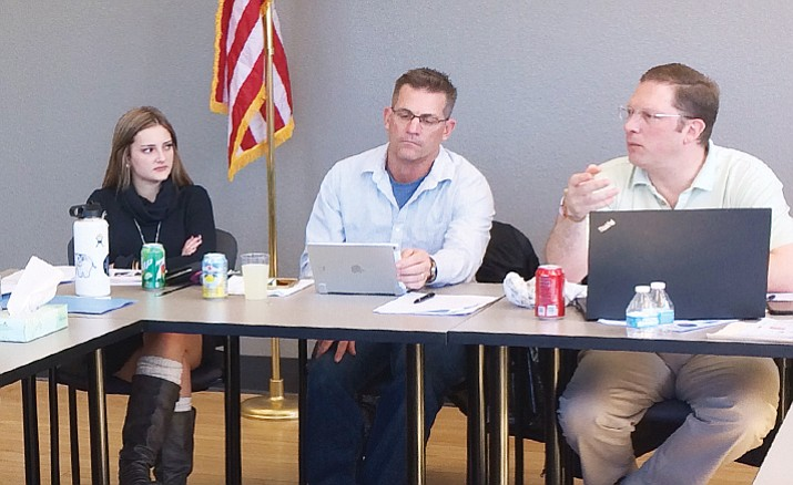 From left: Prescott High School senior board representative Alexa Rosdahl, Prescott Mayor Greg Mengarelli and Prescott Unified School District Chief Financial Officer Brian Moore talk during retreat Friday, March 2, 2018. (Nanci Hutson/Courier)