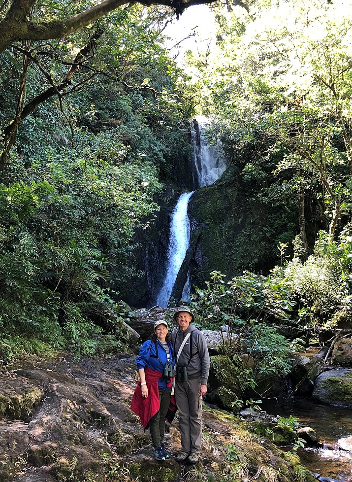 Eric Moore and his wife, Gayla, are pictured on Feb. 22, near Catarata Del Toro, a waterfall that drops 300 feet into a volcanic crater in an elevated nature park in the Guanacaste province of Costa Rica, a tropical rainforest popular for viewing birds. (Eric Moore/Courtesy)