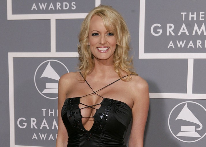 In this Feb. 11, 2007, file photo, adult film actress Stormy Daniels arrives for the 49th Annual Grammy Awards in Los Angeles. Stormy Daniels, whose real name is Stephanie Clifford, is suing President Donald Trump and wants a California judge to invalidate a nondisclosure agreement she signed days before the 2016 presidential election. (AP Photo/Matt Sayles, File)
