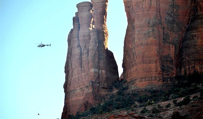 Sedona Fire and a Arizona Department of Public Safety Ranger helicopter from Flagstaff, with the help of the Yavapai Sheriff's Department, rescued a hiker that fell about 15 feet and tumbled another 15 feet on the backside of Cathedral Rock Tuesday afternoon. VVN/Vyto Starinskas