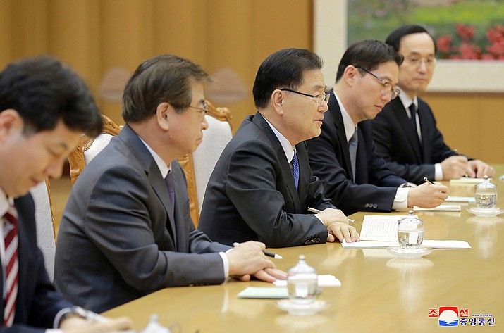 """In this Monday, March 5, 2018 photo, provided by the North Korean government on March 6, South Korean National Security Director Chung Eui-yong, center, talks with North Korean leader Kim Jong Un, unseen, in Pyongyang, North Korea. Independent journalists were not given access to cover the event depicted in this image distributed by the North Korean government. The content of this image is as provided and cannot be independently verified. Korean language watermark on image as provided by source reads: """"KCNA"""" which is the abbreviation for Korean Central News Agency. (Korean Central News Agency/Korea News Service)"""
