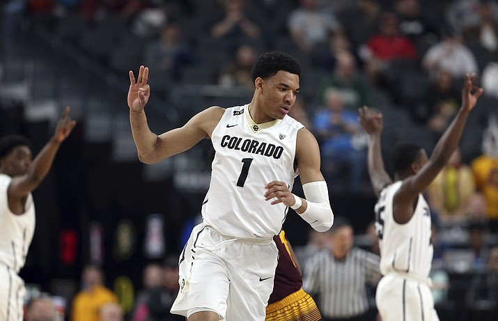Colorado's Tyler Bey reacts after sinking a three-point shot during the second half of an NCAA college basketball game against Arizona State in the first round of the Pac-12 men's tournament Wednesday, March 7, 2018, in Las Vegas. (Isaac Brekken/AP)