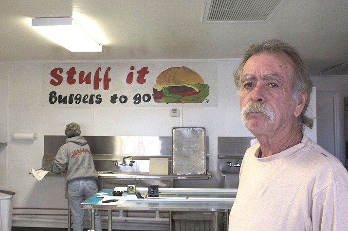 Larry Younce and his wife, Leilana, cleaning in the background, expect to open Stuff It Burger on Monday at 2170 E. Northern Ave., one of several restaurants opening or coming to Kingman.