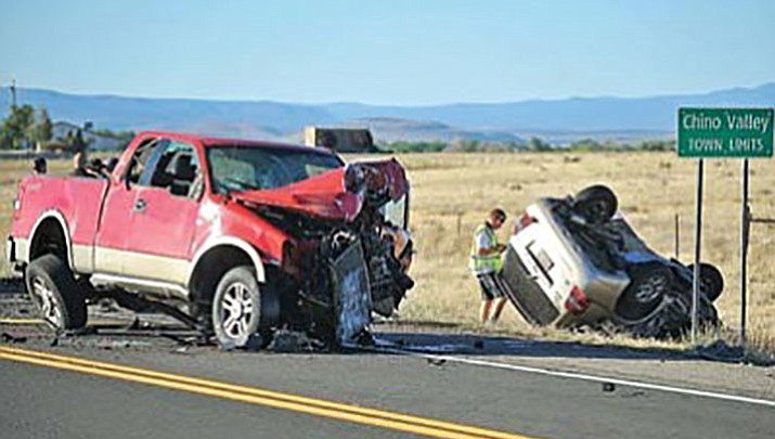 A member of the Chino Valley Police Department Accident Reconstruction Team inspects the scene of a double-fatal car wreck on Highway 89 just south of Chino Valley on June 7, 2011.